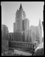 Wurts Bros. Madison Avenue between 26th and 27th Street. New York Life Insurance Building, view looking S.E. from N.W. corner of 28th Street, with foundation of new building in foreground. 1961. Museum of the City of New York. X2010.7.1.10170