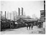 Arthur Hosking. Fulton Ferry. Pier No. 17. Fulton Ferry where Walt Whitman used to come and go on the East River. Banker's Trust tower in the distance. 1920. Museum of the City of New York. X2010.18.194
