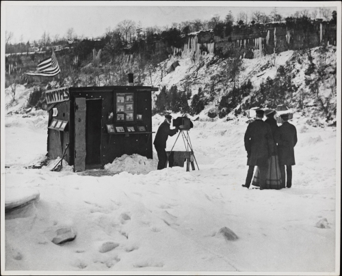 Robert L. Bracklow, Photographer taking a portrait outside of a tintypes booth in the snow, 1880. Museum of the City of New York, 93.91.271.