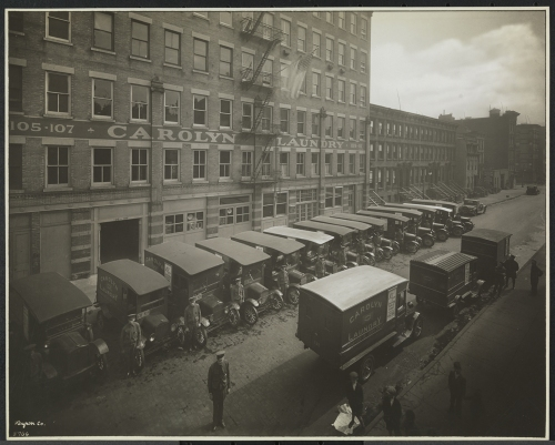 Byron Company (New York, N.Y.). Carolyn Laundry, 111 East 128th St., Building, With Auto Trucks, 1929. Museum of the City of New York. 93.1.1.6829