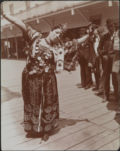 Woman gypsy/dancer posing outside at Coney Island.