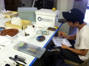 Archival Fellow Hoang Tran surveys objects at the Museum's offsite facility.