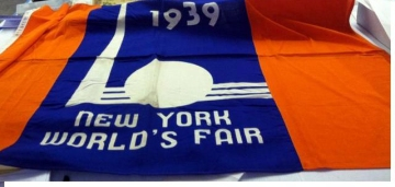 The World's Fair team uncovers a flag from the 1939 Fair.