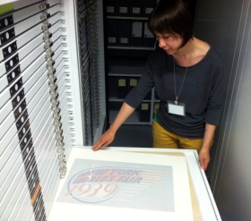 Project Archivist Annie Tummino surveys design renderings in the Museum's Curatorial Center.