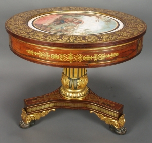 Attributed to Duncan Phyfe (1768-1854), New York, N.Y., circa 1827, rosewood veneer, gilding, plaster, brass, pine, mahogany.  Height: 29 inches,  diameter of top: 36 inches.  Museum of the City of New York, Gift of Mrs. Egerton L. Winthrop, 36.160.