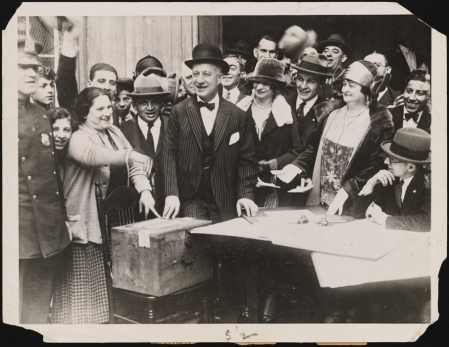Smith and members of his family at the Oliver Street polling station. 1924. Museum of the City of New York. f2012.58.1175