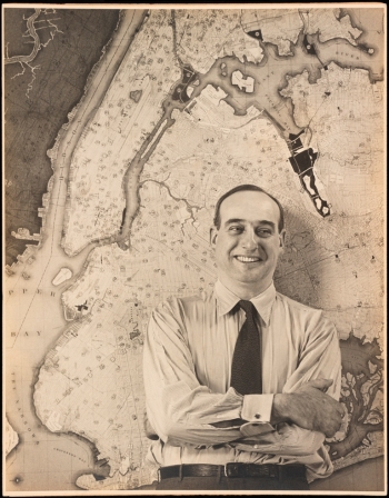 Unknown. Robert Moses in front of a map of New York City. ca. 1925-1940. Museum of the City of New York. F2012.58.960
