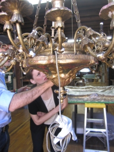 The author and master gilder Giovanni Bucchi examine the gilded surface