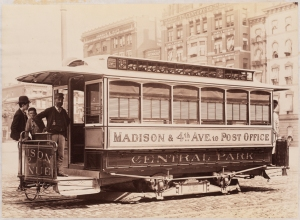 Photograph taken by the Pach Brothers for the John Stephenson Company. Electric Cars Madison & 4th Avenue to Post Office, Central Park No. 12 streetcar with Thomson-Houston motor. ca. 1890. Museum of the City of New York. 44.295.379