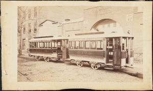 Photograph taken for the John Stephenson Company by unknown photographer. Cable Cars Kansas City Railway Co. Nos. 18 and 17 streetcars, Woodland Avenue via 8th & 9th to Union Depot. ca. 1885. Museum of the City of New York. 44.295.451