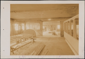 Photograph taken for the John Stephenson Company by unknown photographer. Factory Interior of the John Stephenson Company factory at 47 East 27th Street, making a streetcar roof. ca. 1889. Museum of the City of New York. 44.295.480