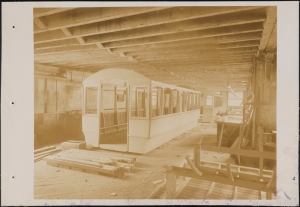 Photograph taken for the John Stephenson Company by unknown photographer. Factory Interior of the John Stephenson Company factory at 47 East 27th Street, streetcar near completion. ca. 1889. Museum of the City of New York. 44.295.481