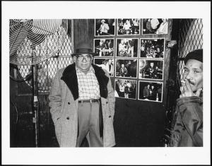 Mikey at the bar, next to my photographs. I loved hanging out, having a beer, taking pictures, listening to what people said about the neighbor-hood. People were open and generous with me, Mel Rosenthal, 1976-1982. Museum of the City of New York. 2013.12.14.