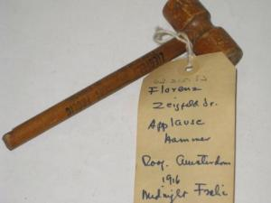 Souvenir - wooden applause hammer from Ziegfeld's Midnight Frolic atop New Amsterdam Theatre, ca. 1916. Museum of the City of New York, 62.215.53.