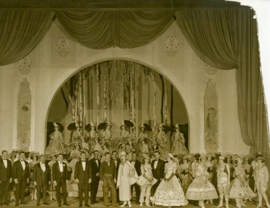 Stage ensemble from the Midnight Frolic with Will Rogers (center), 1917. From the Theater Collection. Museum of the City of New York, 74.92.51.