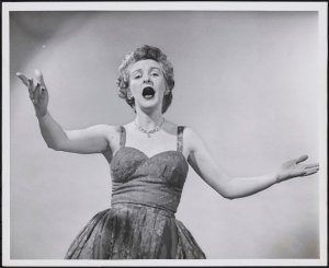 "Photographer unknown. Elaine Stritch as Mrs. Sally Adams in ""Call Me Madam"". ca. 1952. Museum of the City of New York. 68.80.4789"