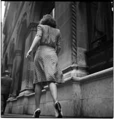 Street Conversations [Woman walking down the street.] ©SK Film Archives/Museum of the City of New York.