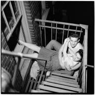 Stanley Kubrick for LOOK magazine, 1946.Park Benches - Love is Everywhere [Couple flirting on a fire escape.] ©SK Film Archives/Museum of the City of New York.