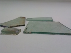 Crown window glass fragments of varying thickness