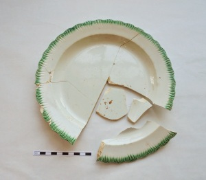 Ceramic pearlware dish with green shell-edged design. Shell-edged dishes were one of the cheapest wares with color decoration during the late 18th to mid 18th century.