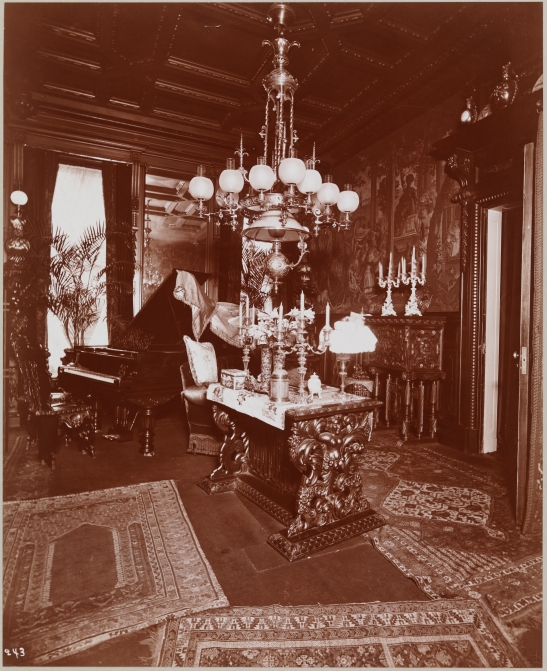 The music room of the Theodore (?--Henry Osborne?) Havemeyer (sugar refiner) residence at Madison Avenue and 38th Street. A piano and other furnishings are visible.