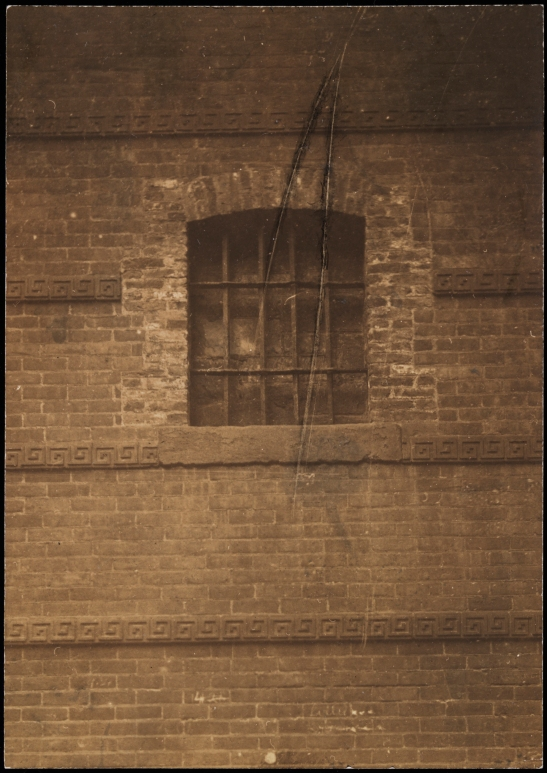 [Detail of window from Old Sugar House in Rhinelander Building.]