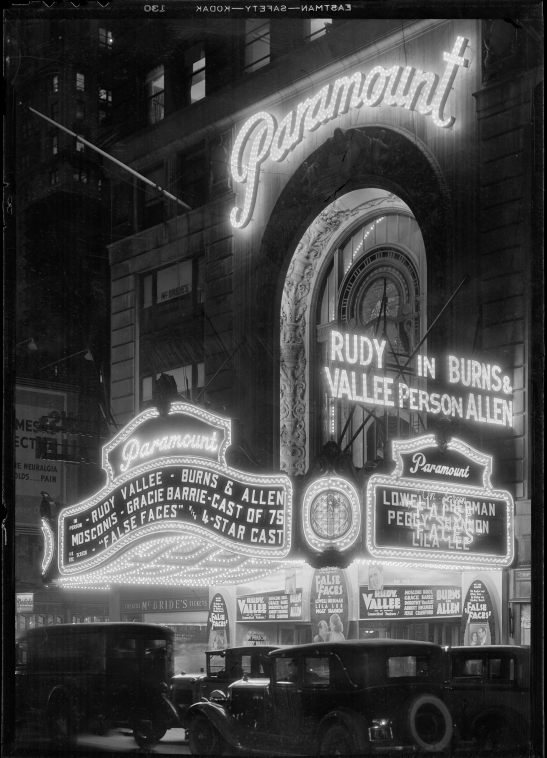 View of Times Square at night, showing the Paramount Theatre marquee.