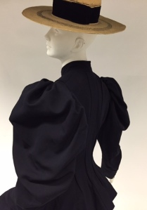 Bicycling Ensemble, ca. 1895, Navy wool broadcloth; brimmed leghorn straw hat originally worn with ensemble. Gift of Mrs. John Hubbard, 41.190.23a-d; 41.190.3 (hat)