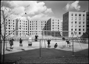 Wurts Bros. (New York, N.Y.), [Vernon Boulevard. Queensbridge Housing Project New York City Housing Project #N.Y. 5-2, exterior of first unit finished, proof size, children on swing.], 1939. Museum of the City of New York. X2010.7.1.16661