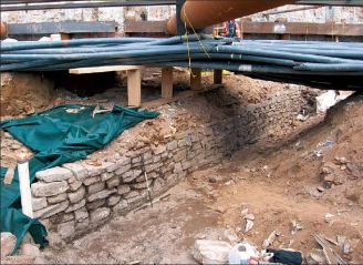 A segment of the Battery Wall exposed beneath modern utility lines during the South Ferry Terminal Project in 2005. This segment was nearly 40 feet long. Image from South Ferry Terminal Public Report, May 2011.