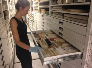 Madeleiene Hazelwood, Collections Assistant, accessing fans in the Costumes and Textiles storage area of the Curatorial Center.