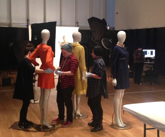 """Dressing Room"" team preparing garments for photography."
