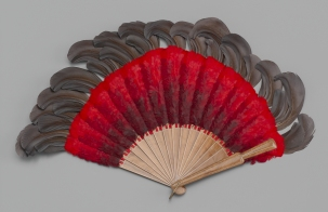Brisé fan of red and brown feathers, ca. 1910. Museum of the City of New York, 69.102.10.