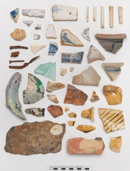 Fragments of pottery, tiles, nails, stone, and smoking pipes from the South Ferry Terminal Collection. Image courtesy of the Museum of the City of New York.