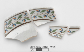 Fragments of a beautifully painted saucer from Whitehall Slip.