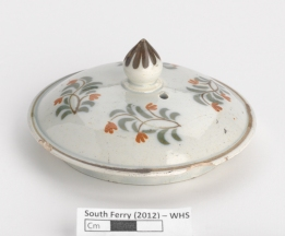 A painted teapot lid from Whitehall Slip.