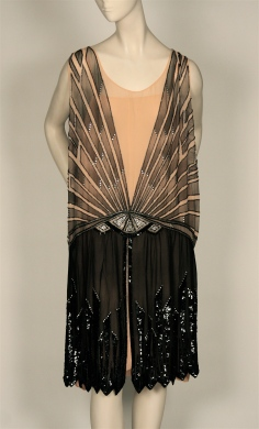Evening dress in silver lame with applied silver bugle beads and pearls in swirl motif, 1926-1927. Museum of the City of New York, 72.206AB.