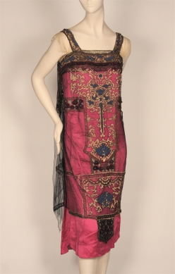 Evening dress in black net over magenta satin with gold metallic and chenille embroidery, ca 1920s. Museum of the City of New York, 79.15.7.