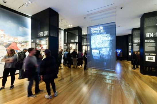 Visitors in gallery 2, World City, 1898-2012. Photograph by Filip Wolak Courtesy MCNY.