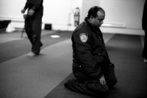 Robert Gerhardt. NYPD Traffic Officer at Prayers, Park 51, Manhattan, NY, 2012. Courtesy of the Museum of the City of New York and the photographer (promised gift).
