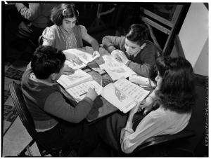 Alexander Alland. Turkish American children at table with workbooks, ca. 1940. Museum of the City of New York, 94.104.776.