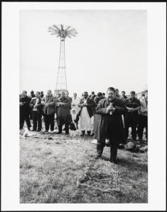 Mel Rosenthal (1940-) Men observe the call to prayer; Astroland Amusement Park, Coney Island, ca. 2011. Museum of the City of New York, 2006.37.11.