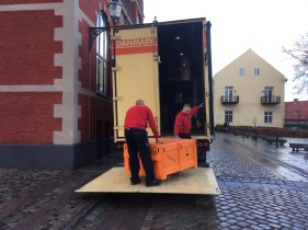 Unloading on cobbled streets.