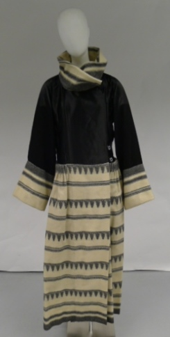 Paul Poiret. Cairo afternoon coat in black satin and white wool, 1921. Worn by donor. Museum of the City of New York, 56.234.3. Gift of Mrs. Henry Clews.