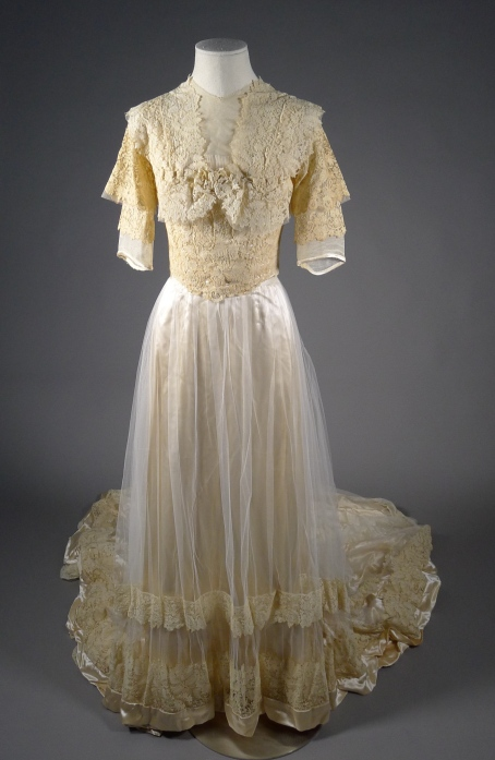Wedding dress in cream slipper satin and lace, worn by Mrs. Theodore Roosevelt, Jr. at her wedding on June 20, 1910, at the Fifth Avenue Presbyterian Church. Museum of the City of New York, 81.100.1AB. Gift of Mrs. William McMillan.